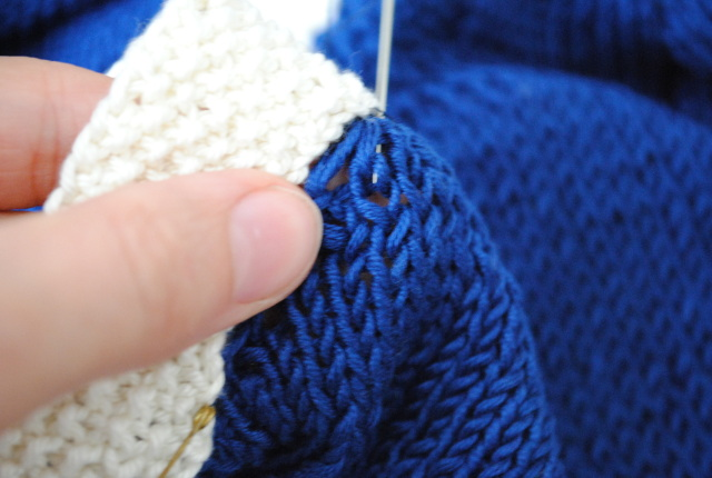 sewing knitting together with backstitch - first stitch forward